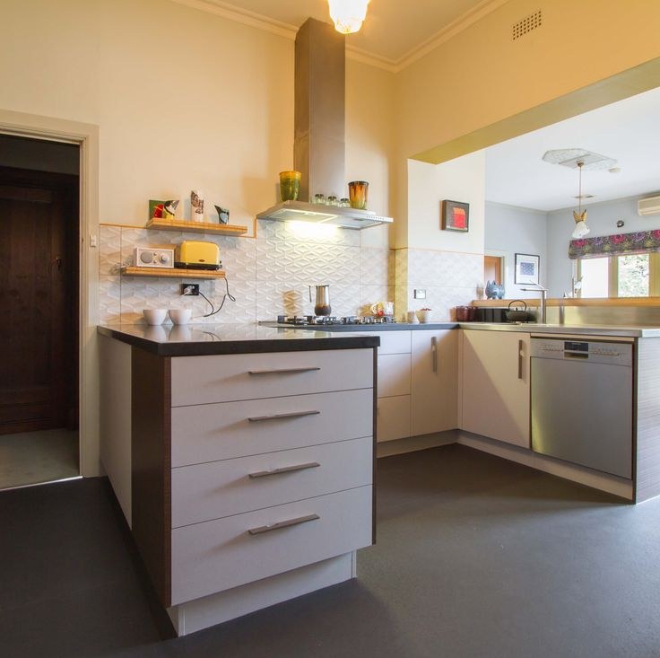 A quirky kitchen in a compact space with interesting features and a mix of textures.  www.thekitchendesigncentre.com.au @thekitchen_designcentre