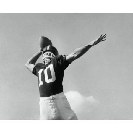 Low angle view of a football player throwing a football Canvas Art - (18 x 24)