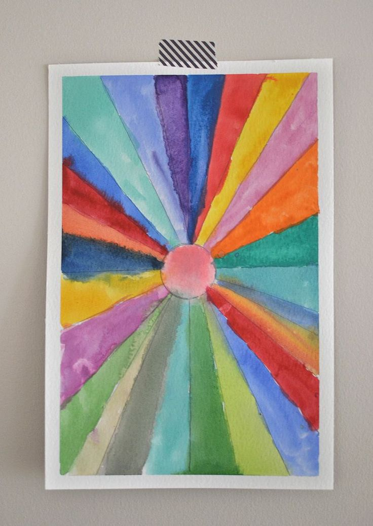 kids made sunburst paintings with a ruler and watercolors