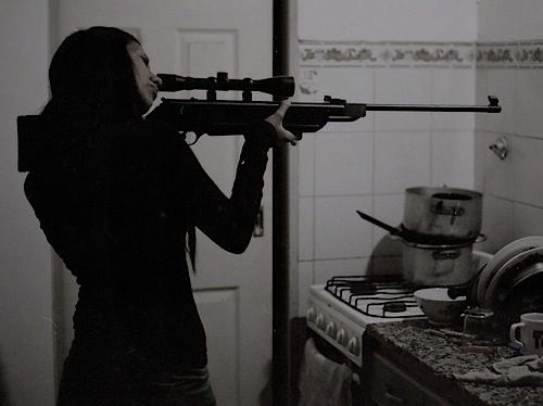 Lei, though this is not how to hold a gun properly. She'd jab her eye out holding it like that!