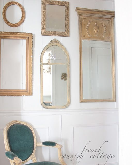 vintage mirrors gallery wall gold frames French