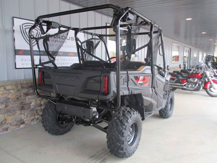 """New 2016 Honda Pioneerâ""""¢ 1000-5 ATVs For Sale in Minnesota. GET THIS NEW 2016 HONDA PIONEER 1000-5 POWER STEERING MODEL IN RED NOW ON SALE FOR $ 14,195.00 AT CAROUSEL MOTORSPORTS IN DELANO. MSRP on this unit, Model # SXS10M5PG IS $ 16,199.00 + $ 750.00 destination. The all new Honda Pioneer 1000 5 seat Deluxe now at the top of the UTV class!! Powered Honda's class-leading displacement in a compact engine size. The 999cc liquid-cooled inline twin utilizes the same Unicam® cylinder head…"""