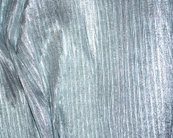 Pleated lame fabric Silver.. 52 inches wide.. 40 poly 60 metallic.. great for costume, doll clothing, crafts, decor, pageant