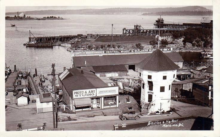 Nanaimo, BC, Bastion & Nanaimo wharf ca1920s, coaling wharves in background.
