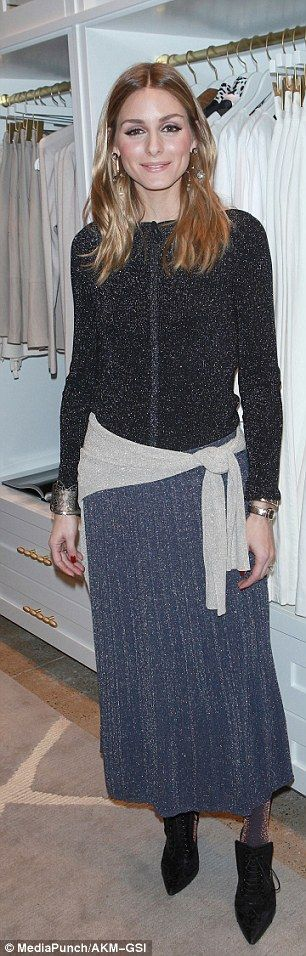 Toasty: Inside Banana Republic Soho, she ditched the fur and leather for a cosier zip up a...