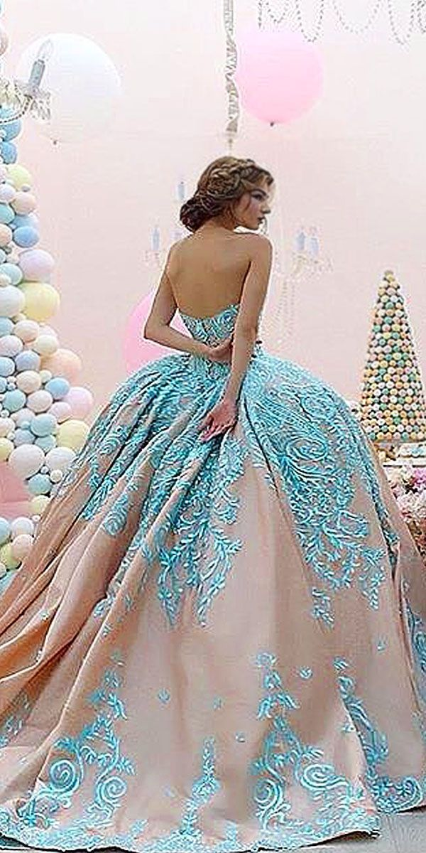 Wedding dresses with color are delightful. This turquoise blue embellishment on a nude colored ball gown dress is lovely.  Our design team can create custom #weddingdresses like this for you.  You an have a couture looking bridal gown for a low cost with our firm.  We specialize in affordable custom designs & #replicaweddingdresses that are not expensive.  Email us for pricing and details.