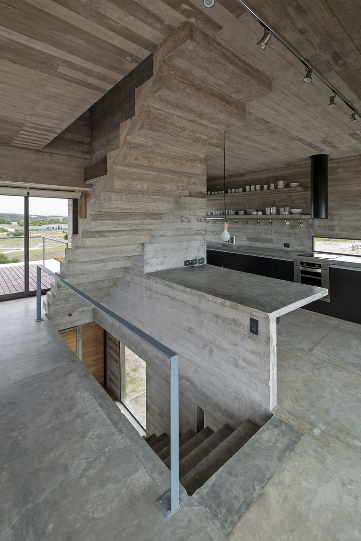 Board-marked concrete house by Luciano Kruk stands on a seaside golf course