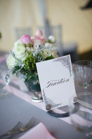 Pink And Gray table cloth and chairs