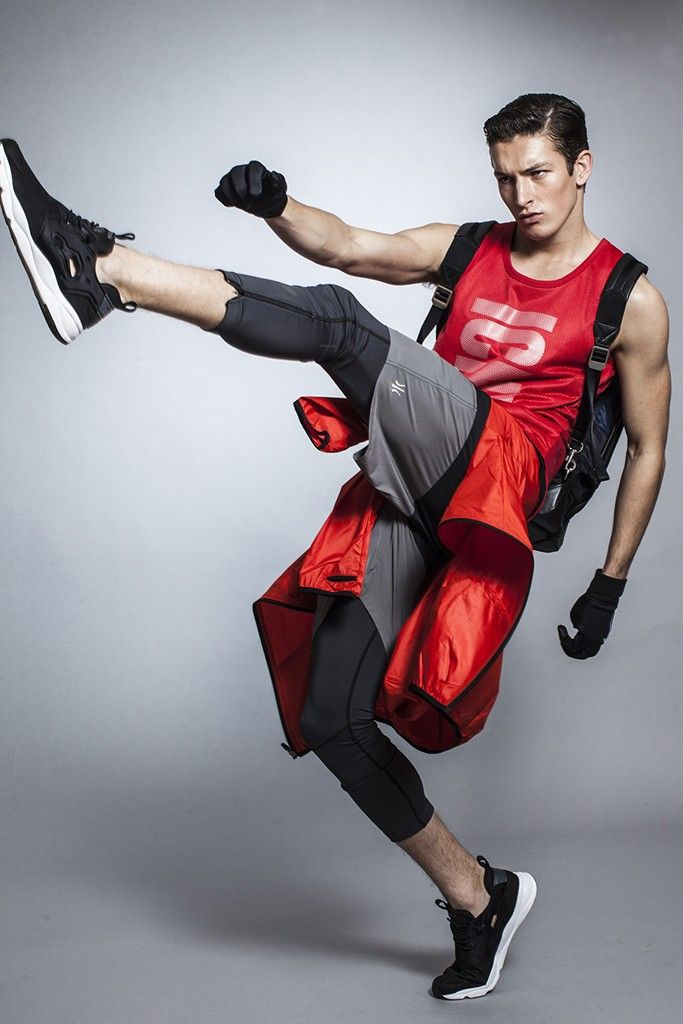 Men's Wear Trend: ICNY's cotton and polyester tank top, Rhone's nylon and polyurethane shorts, Undefeated's polyester and Lycra tights and Ryu's polyester jacket on waist. Alexander Wang backpack; Nike gloves; Reebok sneakers.