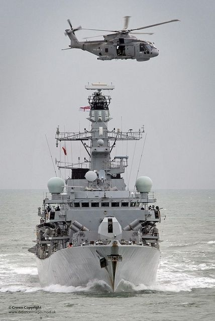 Royal Navy Type 23 Frigate HMS Sutherland with a Merlin Helicopter Overhead by Defence Images, via Flickr