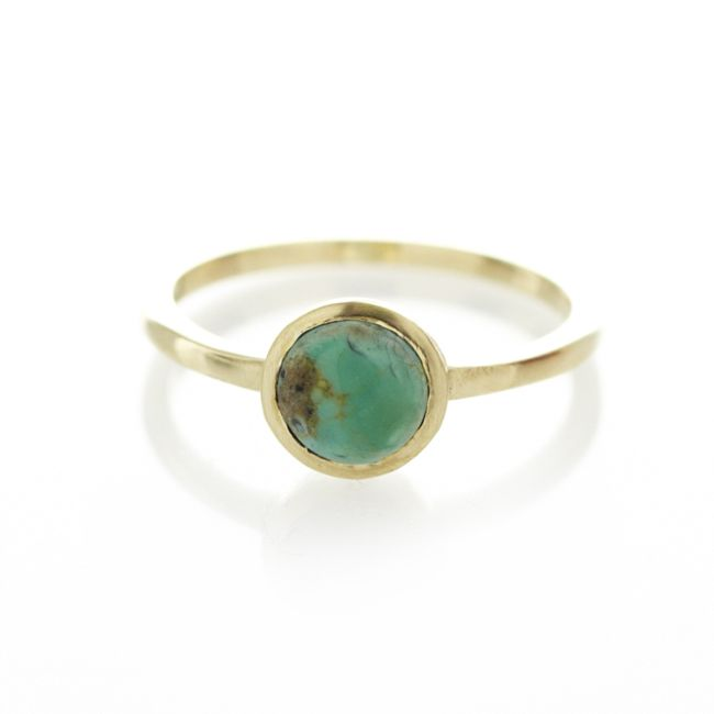 A one of a kind 9ct yellow gold ring, with centeredturquoise gemstone.  When ordering one of our gold luxury rings please provide us with your exact ring size. This can be done in the comment box once your order has been placed.   To find out more about ring sizes please visit the information page on the menu above.   Our luxury gold rings are only available to ship within South Africa.