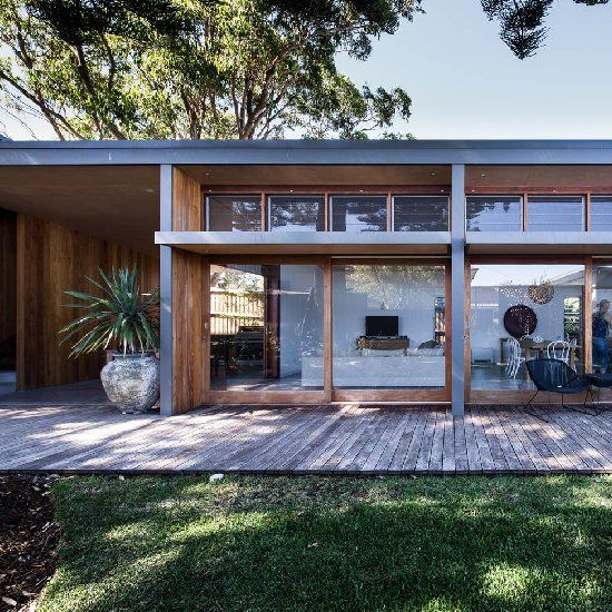 Bourne Blue architecture created the design for this eco inspired home with timber and concrete elements.