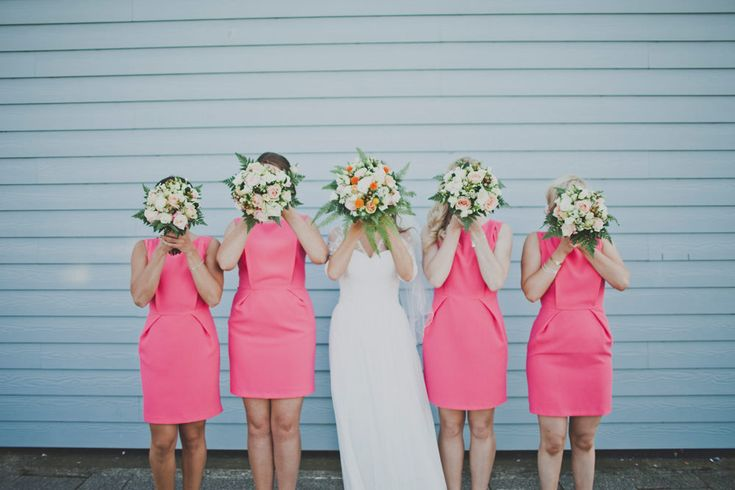 Images by Igor Demba Photography - Personalised plain gown with Lace & Bright Pink Bridesmaid Dresses for a Laid Back Bohemian Coastal Wedding at industrial restaurant the Lobster Shack in Whitstable