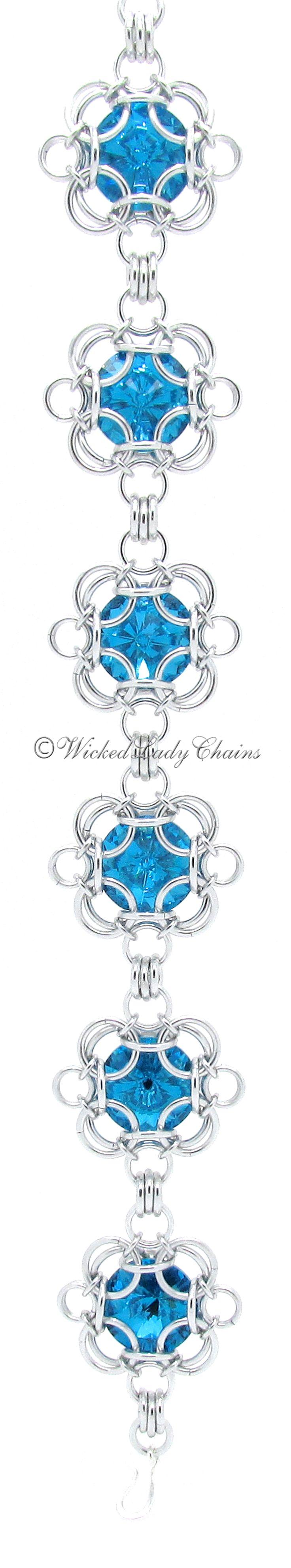 Aqua crystal rivoli bracelet in jewellers grade anodised aluminium.  Original tutorial used can be found here: https://www.etsy.com/listing/250690726/rivoli-power?ref=shop_home_active_1