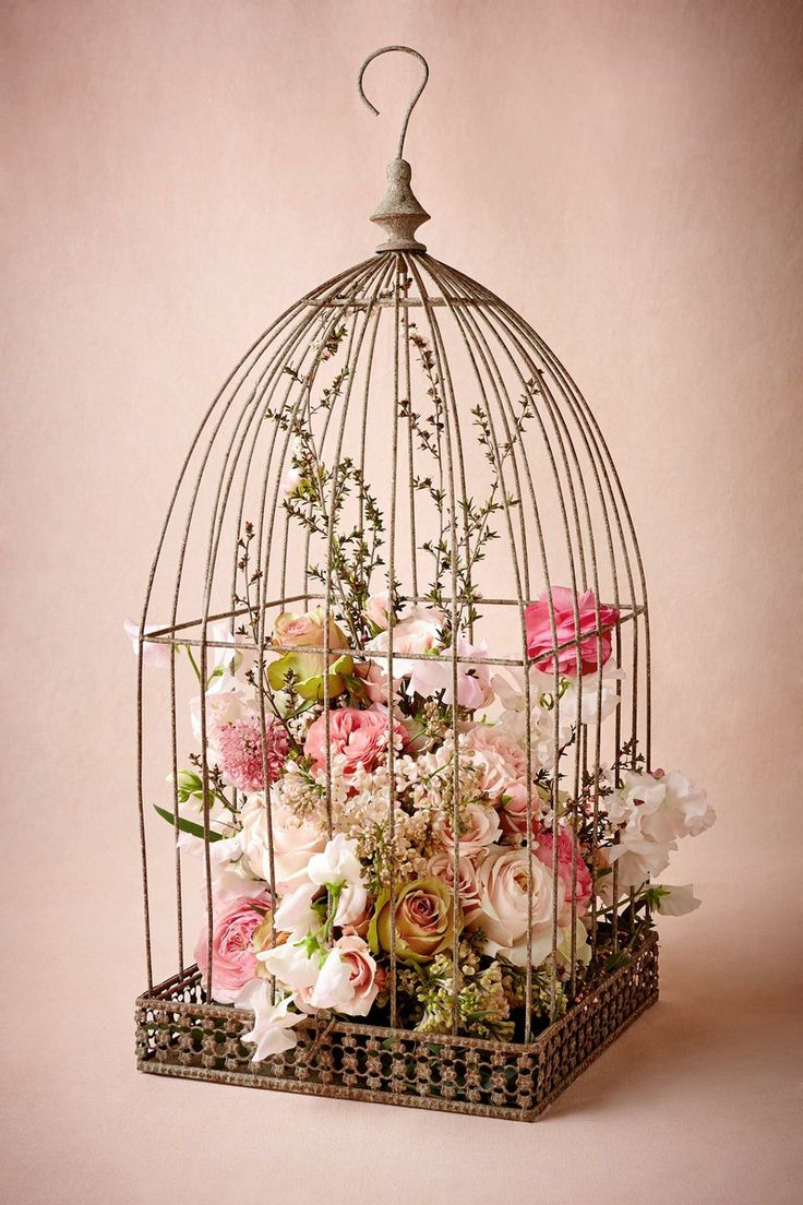 birdcage flower holder, my Mom did this once and it turned out super pretty hanging from the ceiling <3