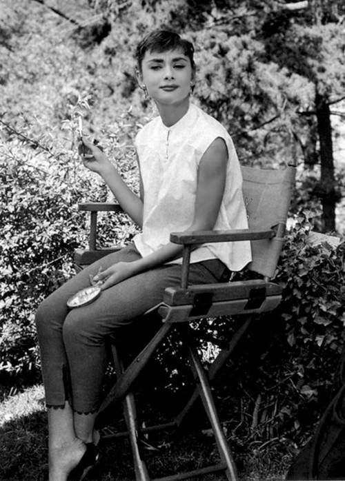 Audrey Hepburn taking a little work break in 1953; and, looking adorable while feeling a bit interrupted!