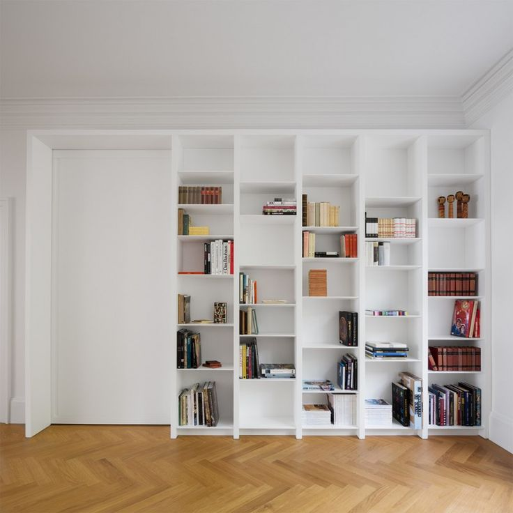 Modern Home Library Idea White Bookshelves Inserted In Wall Medium Toned  Wood Floors Of Large Selections