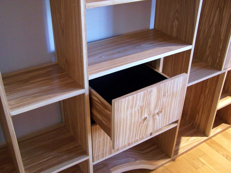 felt lined drawers within this handmade curved wooden bookcase by - Wooden Bookcases