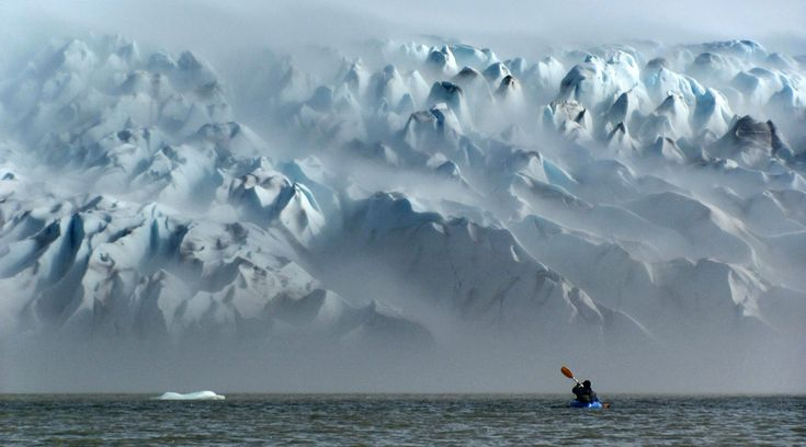 Kayaking ... Patagonia. In the background, San Quintin Glacier, The largest glacier of the Northern Patagonian Ice Field in Chile.