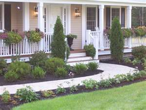 like the planters on the porch & plantings along each side of the sidewalk