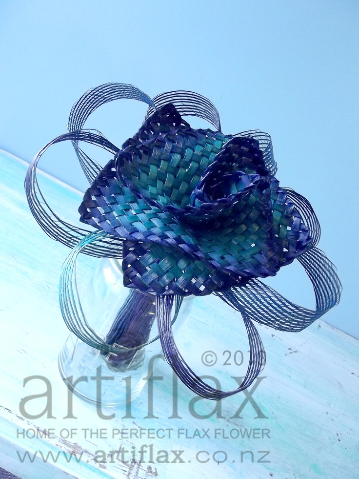 Flax flowers by Artiflax. Large flax lily with authentic Hapene flax foliage in beautiful ocean/paua colours.