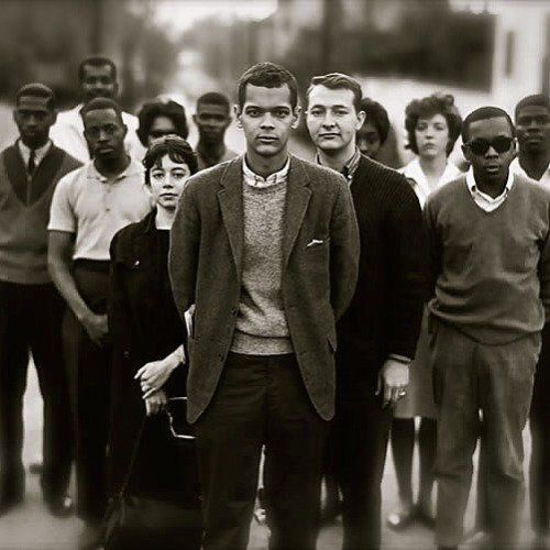 SNCC organization- Julian Bond with members of the Student Non-Violent Coordinating Committee - [In 1960, Bond helped found the Student Nonviolent Coordinating Committee (SNCC) and earlier that year, he helped create the Atlanta University student civil rights organization, which directed several years of nonviolent protests and won integration of Atlanta's movie theaters, lunch counters, and parks.]