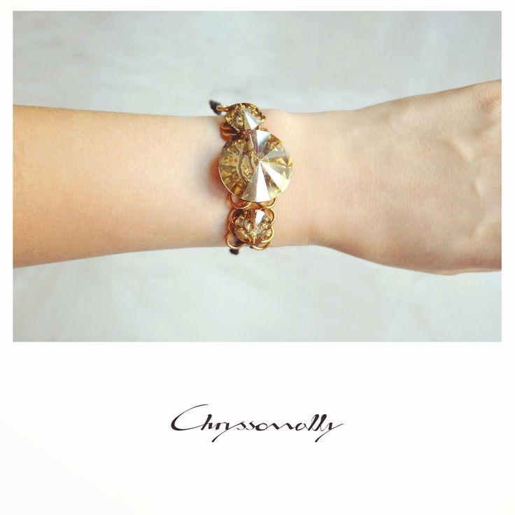 JEWELRY   Chryssomally    Art & Fashion Designer - A striking bracelet with gold Swarovski crystals, gold steel chain and black silk cord