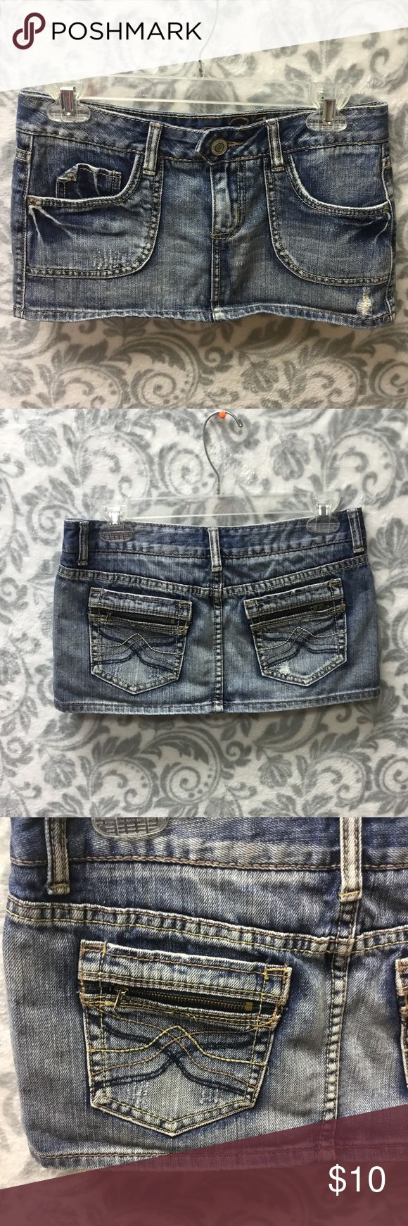 Rue 21 mini jean skirt size 1/2 zipper pockets In great condition  All fading and rips were done by the designer  Two front pockets  Two back pockets with zippers  100% cotton  If you have any questions or need specific measurements, please feel free to ask!  Bundle and receive a generous private discount! Rue 21 Skirts Mini
