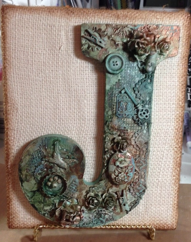 """Mixed media wooden letter """"J"""" mounted on burlap covered canvas using Lindy's Stamp  Gang."""