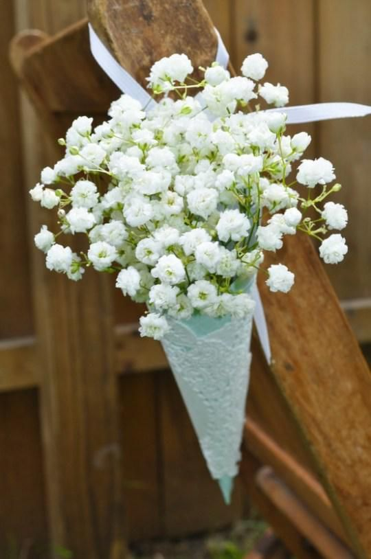 Baby's breath in DIY cone aisle marker    http://m5.paperblog.com/i/5/50159/babys-breath-experiences-rebirth-in-wedding-d-L-oW6uXJ.jpeg