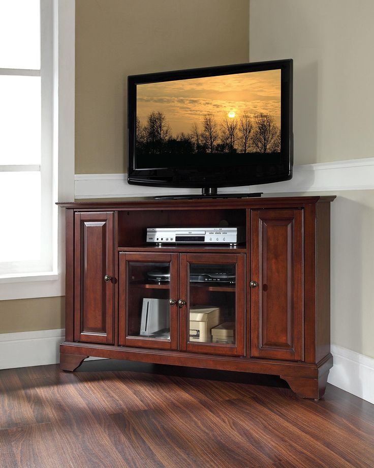 """LaFayette 48"""" Corner TV Stand Vintage Mahogany. Color Brown; Finished Dark Wood; Three Adjustable Shelves; Wire Management; Multi-Step Finish; Accomodates most 52"""" TV's; Metal Hardware; Adjustable Levelers in Legs; Solid Hardwood & Veneer Construction; Beautiful Raised Panel & Tempered Beveled Glass Doors; Hand Rubbed; Length 18; Width 47.75; Assembly Required Yes; Style Transitional; Height 30."""