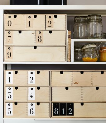 wooden IKEA mini chest of drawers w/ numbered labels - No office is complete w/o a set of shelves. Complement yours w/ some files, magazine archive boxes & smaller storage boxes to help keep everything in its place and out of sight until you need it. Stickers or homemade labels look smart and help you keep a tab on contents