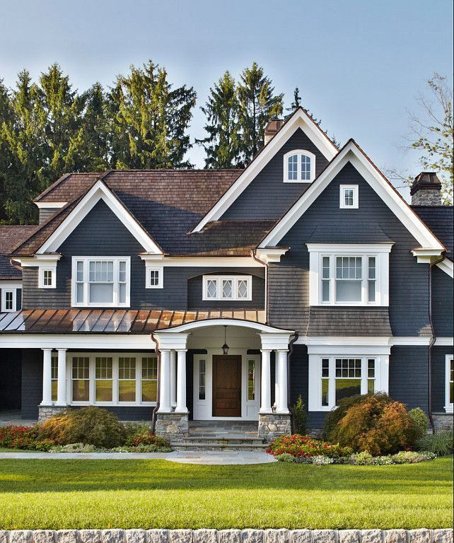 Love the dark blue color of this siding with the white trim & white windows.:
