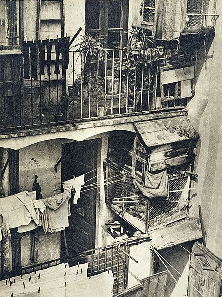 MICHAELIS , Margaret | No title [Houses in the Barrio Chino. Balconies with washing on line and bird cages]