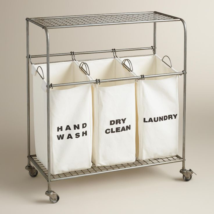 """Three spacious cotton bags labeled """"laundry,"""" """"dry clean"""" and """"hand wash"""" keep your clothes neatly sorted, while the flat surface on top is perfect for folding. >> #WorldMarket Laundry Shop"""