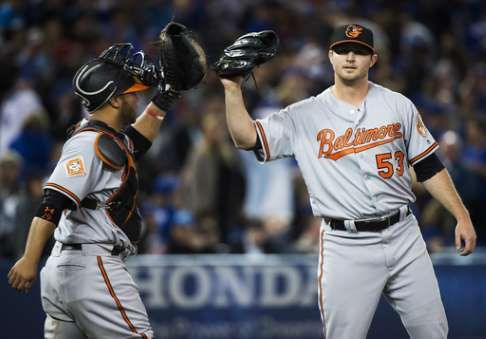 Orioles place closer Britton on 10-day DL with sore forearm  -  April 16, 2017:     Baltimore Orioles closing pitcher Zach Britton (53) celebrates with Welington Castillo (29) after the Orioles defeated the Toronto Blue Jays in a baseball game in Toronto on Thursday, April 13, 2017. (Nathan Denette/The Canadian Press via AP)