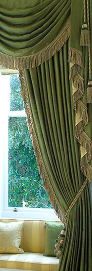 Well-dressed fringe follows the jabot - classical swag and drapery treatment in moss green with tawny gold bullion trim