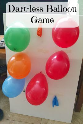 pre-taped tacks. kids used bean bags to hit balloons. balloon will touch tack and pop. prize printed inside