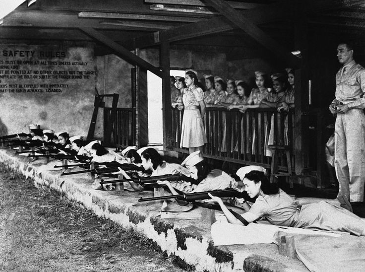 "The first ""Women Guerrilla"" corps has just been formed in the Philippines and Filipino women, trained in their local women's auxiliary service, are seen here hard at work practicing on November 8, 1941, at a rifle range in Manila."