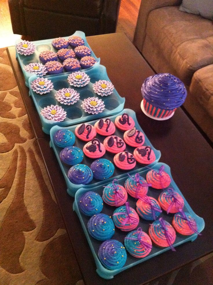 Moroccan themed cupcakes & giant cupcake cake ~ Purple, teal & hot pink cupcakes ~ Baby shower cupcakes ~ Fancy cupcakes  Cupcakes & cupcake cake by: Bella Baby Cakes