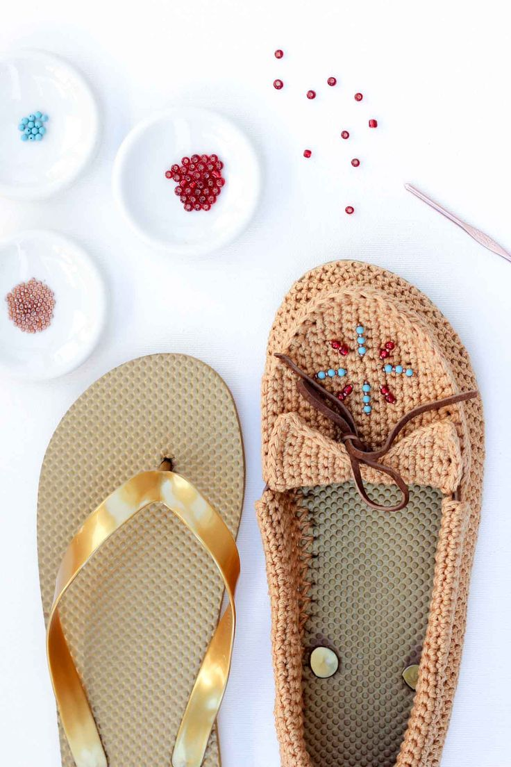 """Learn how to crochet shoes with flip flop soles with this free crochet moccasin pattern and video tutorial! These crochet moccasins make super comfortable women's shoes or slippers and can be customized however you wish. Made from Lion Brand 24/7 Cotton in """"Camel"""" color. Seed beads add the perfect bohemian touch!"""