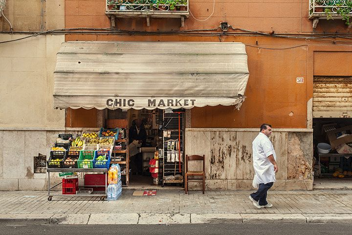 """Carlos Spottorno """"Trapani, Italy, 7 October 2010: a tiny, multi-purpose shop called very optimistically Chic Market. I can't think of a better example of how southern European countries have this positive overblown self-perception – or is it irony?"""""""