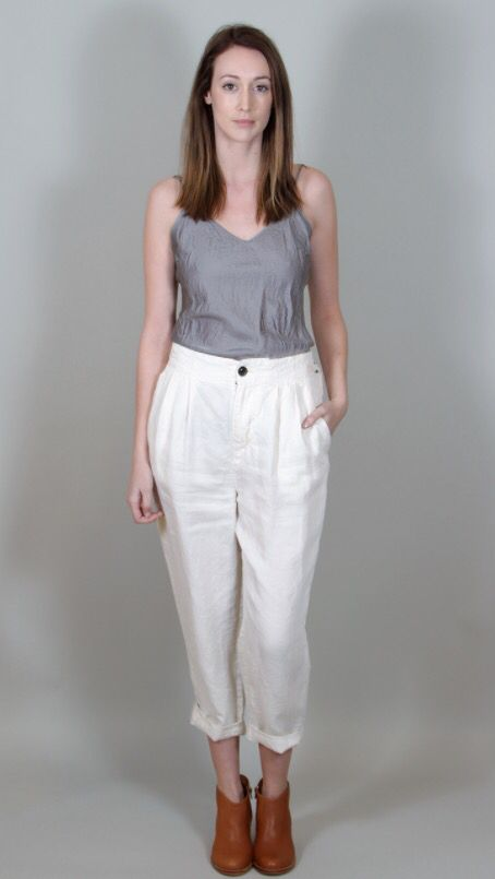 pas de calais - Cropped linen twill pant with front pleats, zipper fly and one button closure, side pockets, twill tape D-ring tabs with belt loops and one welt pocket on back side. Front side is plain white linen twill and back is a light grey pinstripe linen twill. #pasdecalais #linen #pant #pinstripe