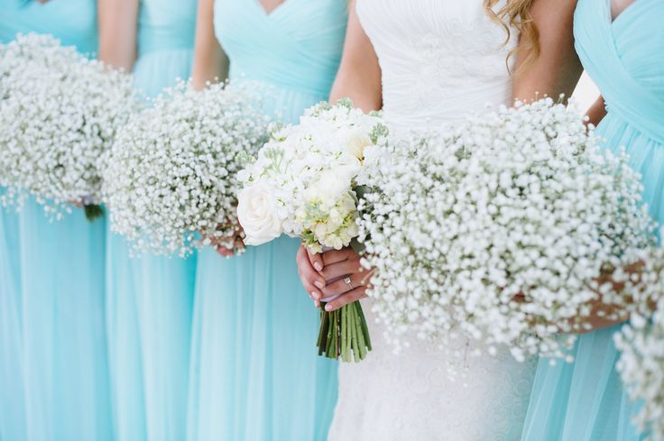 These colors are so pretty together! Love the white bouquets against the baby blue dresses! #weddingcolors