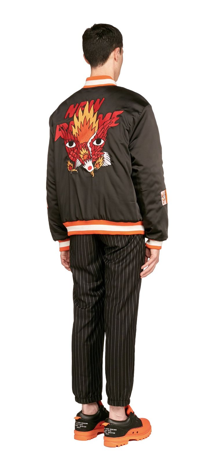 Ricardo Cavolo X Atelier New Regime Guardian Eagle Bomber Jacket (Black) / Made of smooth satin, this medium weight bomber jacket featuresthe Guardian Eagle collab artwork embroidered at the back,depicting the strength, freedom and inspiration that the eagle is known to represent. #ricardocavolo
