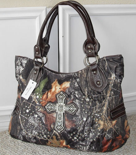 i have a camo purse like this, but no cross, has a huge belt buckel type strap with stones.
