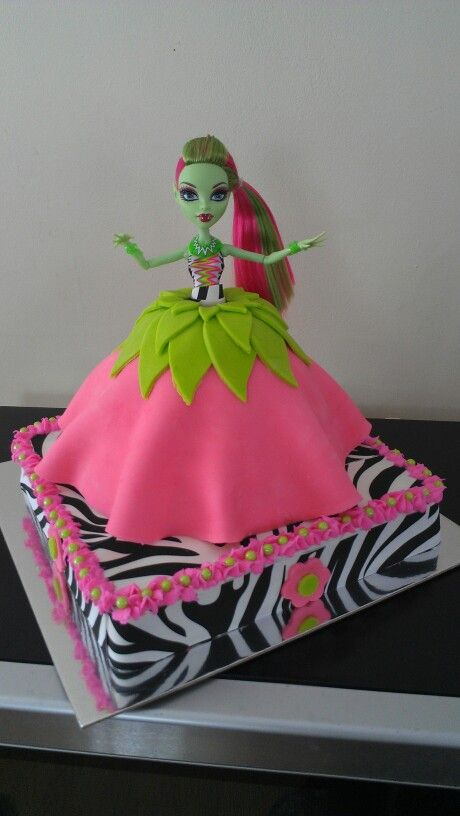 Monster high cake , instead of pink around the bottom i would use purple and teal blue in this cake aswell...that way it ties in with the rest of Jamie's party colors...this is Venus mcflytrapp that Jamie wants on her cake