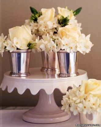 Grouped Paperwhites, Roses, and Star-of-Bethlehem This luminous centerpiece is composed of three silver julep cups filled with paperwhites, roses, and star-of-Bethlehem, set atop a cake stand. After the centerpiece has served its purpose, the three elements can be separated and distributed throughout the house; try placing them on nightstands and bathroom shelves.
