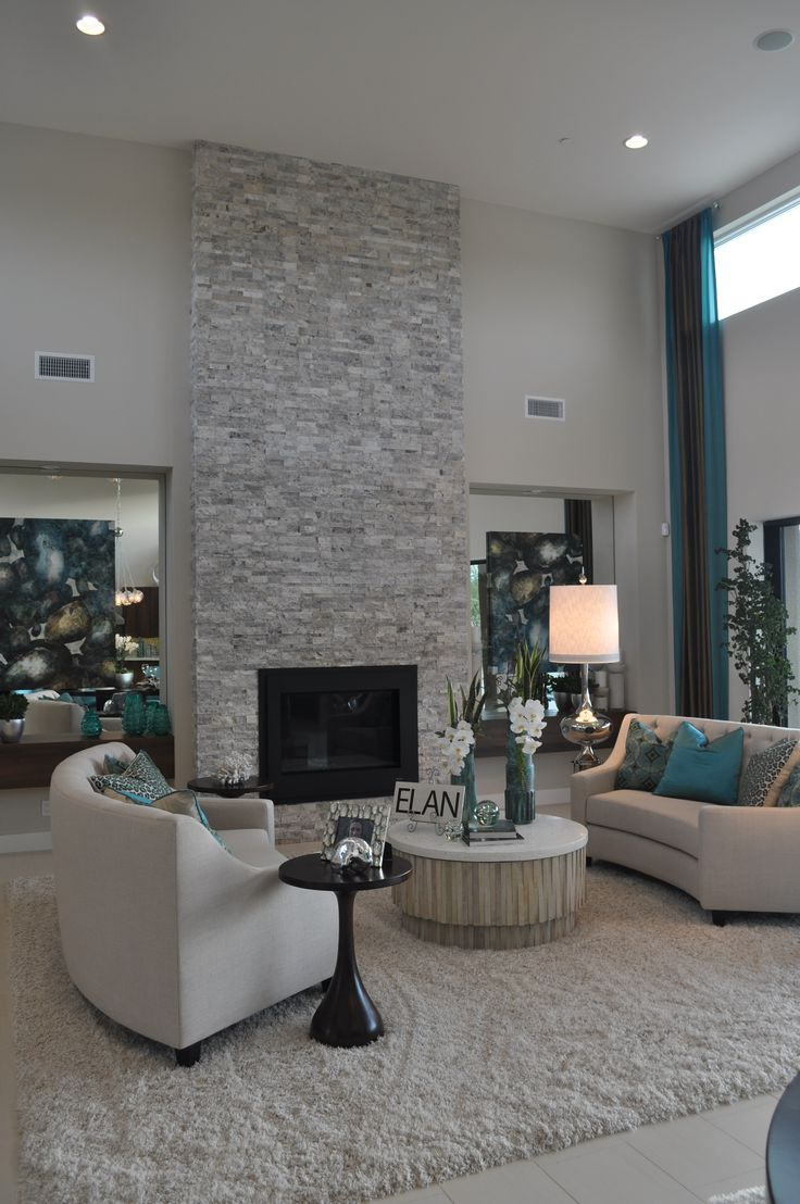 Contemporary living room with floor to ceiling light grey stacked stone fireplace