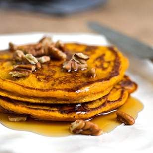 This healthy whole-grain pumpkin pancake recipe produces fluffy cakes with a beautiful orange hue from pureed pumpkin and light crunch from toasted pecans.